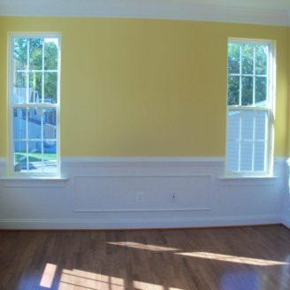Ellicot city painting with white trim and yellow paint on walls