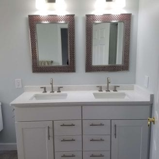 Baltimore Bath remodeling with white vanities