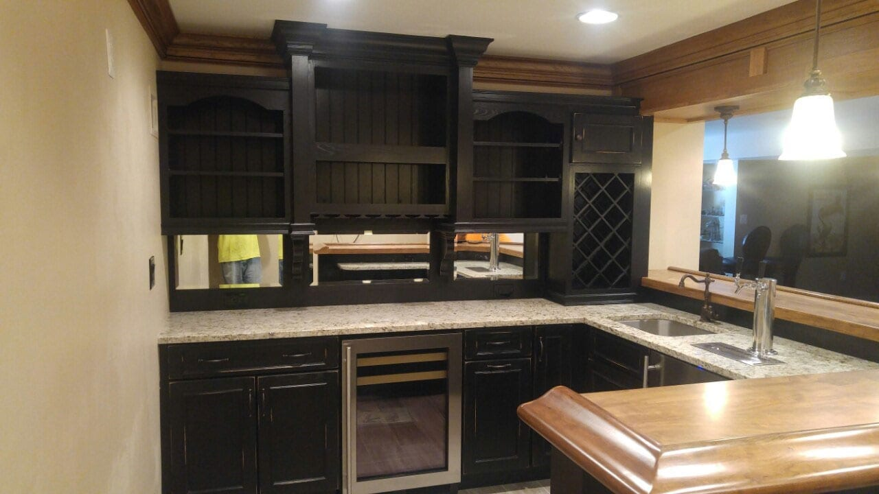 ... Basement Bar Installation With Black Rusted Look Cabinets ...