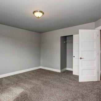 basement-finishing-in-columbia-md-with-carpet-and-gray-paint-on-walls-with-white-trim-and-doors