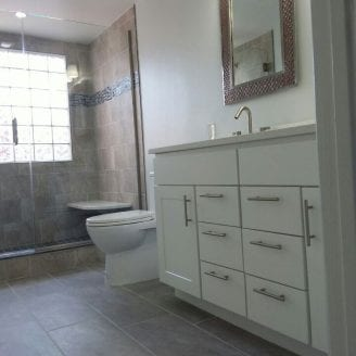 complete-bath remodeling-in-federal-hill-with-white-vanity-and-porelain-floors-and-custom-shower
