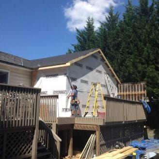 Home addition in Towson MD installing houserap and insullation