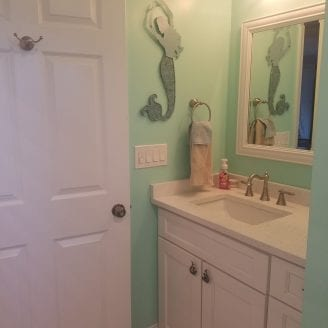 Bath Remodel with white cabinets and top in Dundalk MD