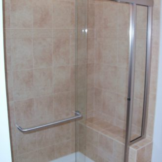 Custom shower remodeling with seat and shower door in Ellicot city MD