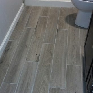 Wood look ceramic floor Bath Remodel in Canton MD