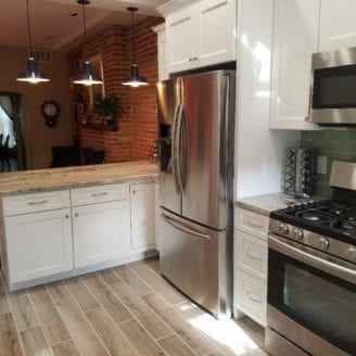 White kitchen cabinets with brown fantasy granite and green tile subway Baltimore installation