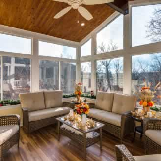 Vinyl Sunroom with wood floor and ceiling paneling