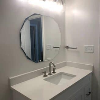 white vanity with quartz counter top